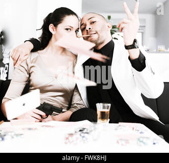 Portrait Of Fashionable Gangster Friends Throwing Cards At Home Stock Photo