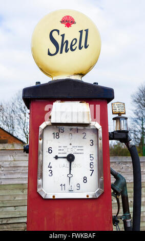 Old fashioned Shell petrol pump at a garage in the Black Country Living Museum, Dudley, West Midlands, UK - Stock Photo