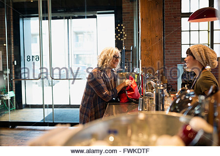 Woman ordering at coffee shop - Stock Photo