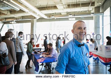 Portrait smiling man bow tie voter polling place - Stock Photo