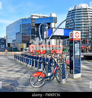 Santander bike hire docking station point at Old Street Station on Tech City Silicon Roundabout junction of Old - Stock Photo