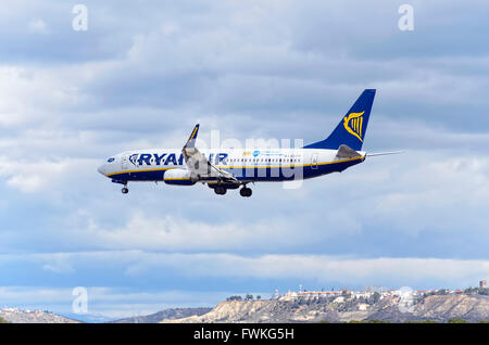 Passenger jet aircraft -Boeing 737-8AS-, of low cost airliner -Ryanair-, is coming, ready to land, to Madrid airport. - Stock Photo