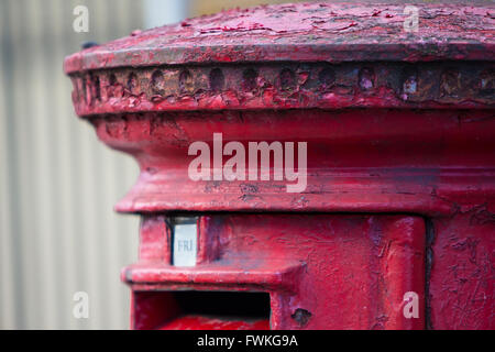 Iconic Red Pillar Post Box London England Decay Dilapidated Peeling - Stock Photo