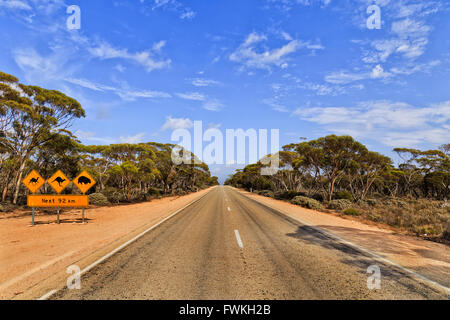 Warning roadsign with information babout wild life animals along unfenced road - Eyre Highway in SOuth AUstralia - Stock Photo