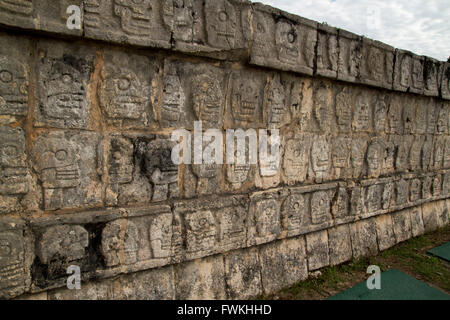 Wall of carved skulls, Mexico - Stock Photo
