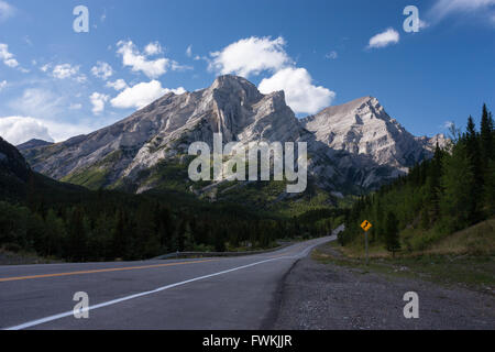 Road passing through Kananaskis Country in Canadian Rockies - Stock Photo