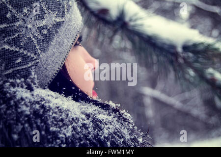 Close-Up Of Young Woman Looking Away During Winter - Stock Photo