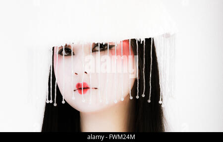 Portrait Of Beautiful Woman Puckering Lips While Wearing White Hat - Stock Photo