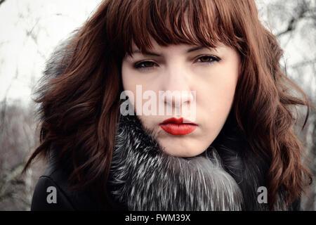 Portrait Of Beautiful Woman Wearing Fur Jacket - Stock Photo