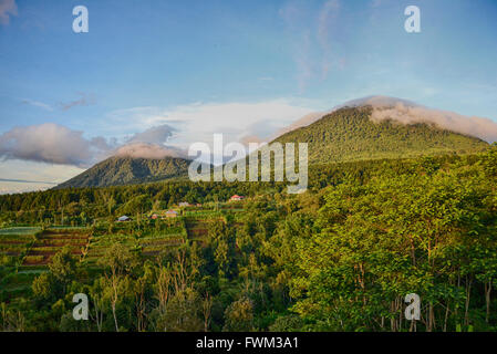 Idyllic Shot Of Green Landscape And Mountains At Tabanan Regency Against Sky - Stock Photo