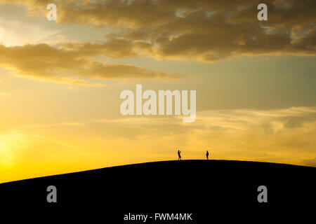 Scenic View Of Silhouette Hill Against Sky During Sunset - Stock Photo