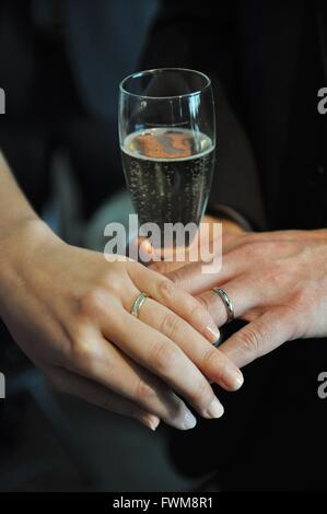 Bride And Groom Showing Off Wedding Rings - Stock Photo