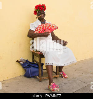 Square full length portrait of a lady posing with a large Cohiba cigar in Cuba. - Stock Photo