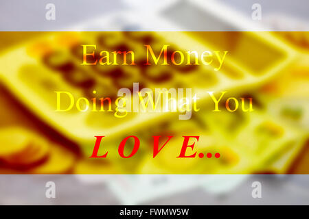 Earn money doing what you love inspirational quote on blur background - Stock Photo