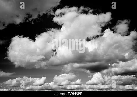 Cumulonimbus cloud formations against a bright sky. UK. - Stock Photo