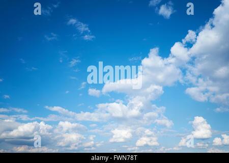 Cumulonimbus cloud formations against a bright blue sky. UK. - Stock Photo