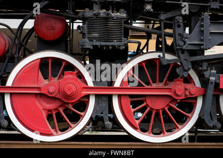 Wheels on a old train from the side - Stock Photo