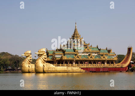 On the Eastern shore of the Kandawgyi Lake (Yangon - Myanmar), the crazy Karaweik Hall is the copy of the Royal - Stock Photo