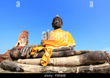 black buddha statue over blue sky - Stock Photo