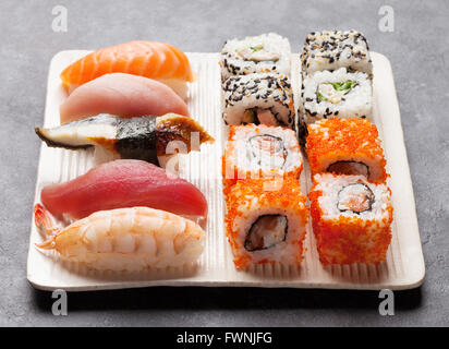 Set of sushi and maki roll on stone table - Stock Photo