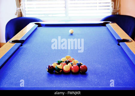 pool ball on old pool table - Stock Photo