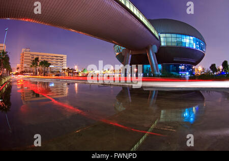 Light Trail and Government Complex Building dome shines at Dusk in Bangkok Thailand. - Stock Photo