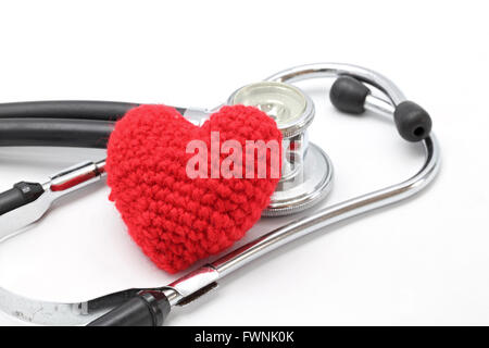 Perspective of Stethoscope and Red Heart on White Background using as Valentine Love Concept (Selective focus on - Stock Photo