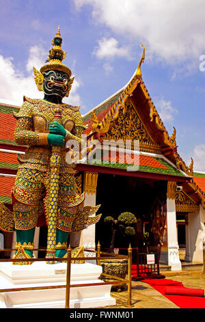 Golden stupa with demon guardian at Grand Palace temple in ...