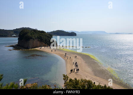 Kagawa, Japan. 20th Mar, 2016. People walk on the Angel Road which connects small island from Shodoshima island - Stock Photo