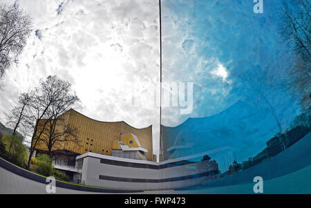 Berlin, Germany. 07th Apr, 2016. The philharmonic is reflected in the blue glass wall of the memorial to the victims - Stock Photo