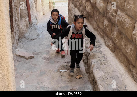 Jerusalem, Israel. 7th April, 2016. Young Palestinian children run through one of the narrow streets and alleys - Stock Photo