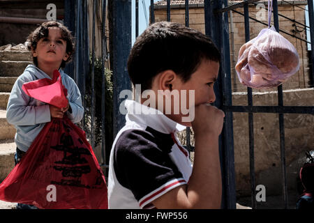 Jerusalem, Israel. 7th April, 2016. Young Palestinian children play at the entrance to what Jewish residents call - Stock Photo