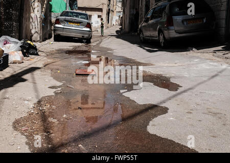 Jerusalem, Israel. 7th April, 2016. Evident neglect and filth in one of the narrow streets and alleys of Silwan. - Stock Photo
