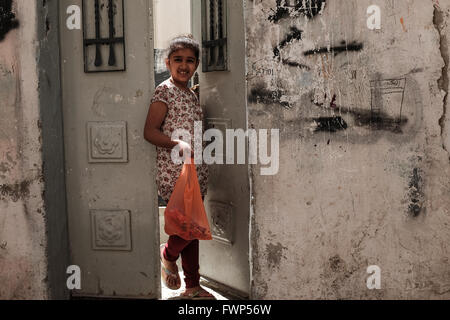 Jerusalem, Israel. 7th April, 2016. A young Palestinian girl leaves her home in one of the narrow streets and alleys - Stock Photo