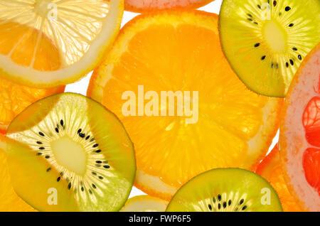 Different sliced juicy citrus fruits