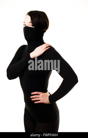 Ninja and Hidden identity: A young person, woman girl, late teens early twenties, slim, brown hair, with her face - Stock Photo