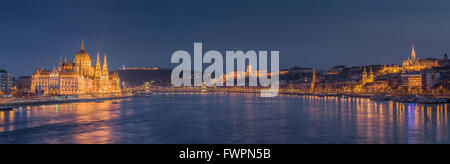 Hungarian parliament building on the banks of the Danube illuminated at night. Budapest, Hungary. - Stock Photo