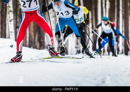 Kyshtym, Russia -  March 26, 2016: group of male skiers going uphill during Championship on cross country skiing - Stock Photo