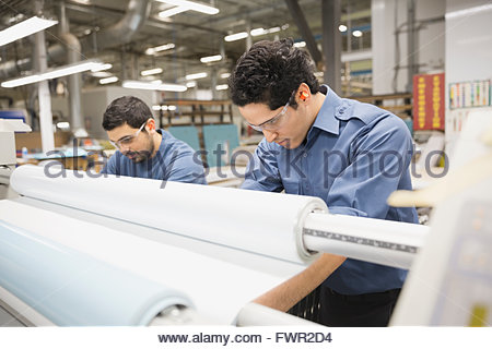 Workers in metal fabrication warehouse - Stock Photo