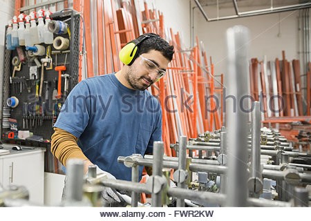 Man working in factory - Stock Photo