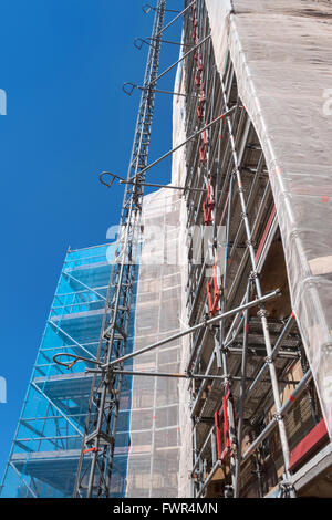 Scaffolding with safety net - Stock Photo