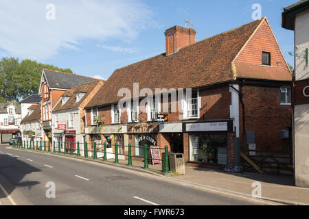 High Street in the small town of Fordingbridge, Hampshire, with various small shops. - Stock Photo