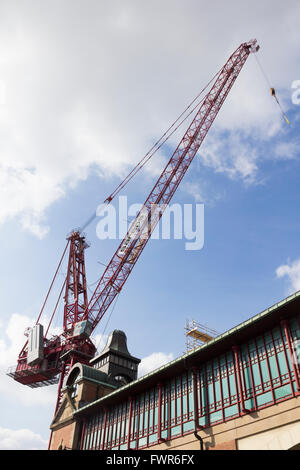 Temporary luffing crane erected in Bolton town centre to aid construction work on the new 9 screen cinema in the - Stock Photo