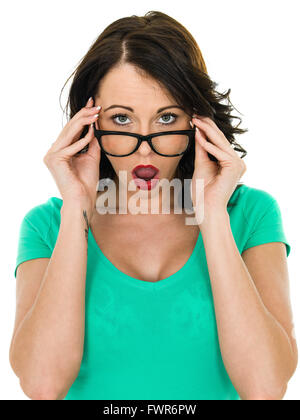 Shocked Young Woman Looking Over Her Glasses With Her Mouth Open in Amazement Isolated Against A White Background - Stock Photo