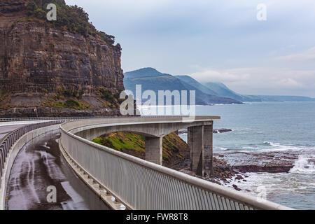 View of the magestic Sea Cliff Bridge, Grand Pacific Drive, Sydney, Australia. - Stock Photo