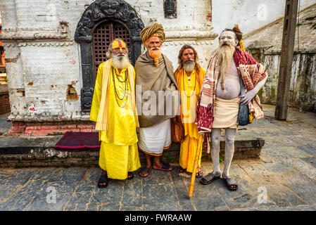 Wandering  Shaiva sadhus (holy men) with traditional long hair and beards in Nepal - Stock Photo