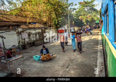 Passengers getting off  the local circle train in Yangon - Stock Photo