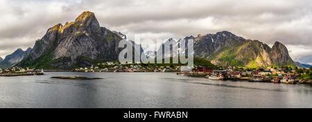 Panorama of Mount Olstind and Reine fishing village on Lofoten islands in Norway. - Stock Photo