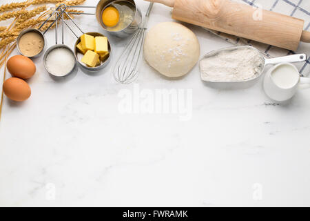 Baking cake, dough recipe ingredients (eggs, flour, milk, butter, sugar) on white table. - Stock Photo