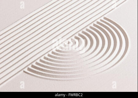 Japanese ZEN garden with raked white sand - Stock Photo
